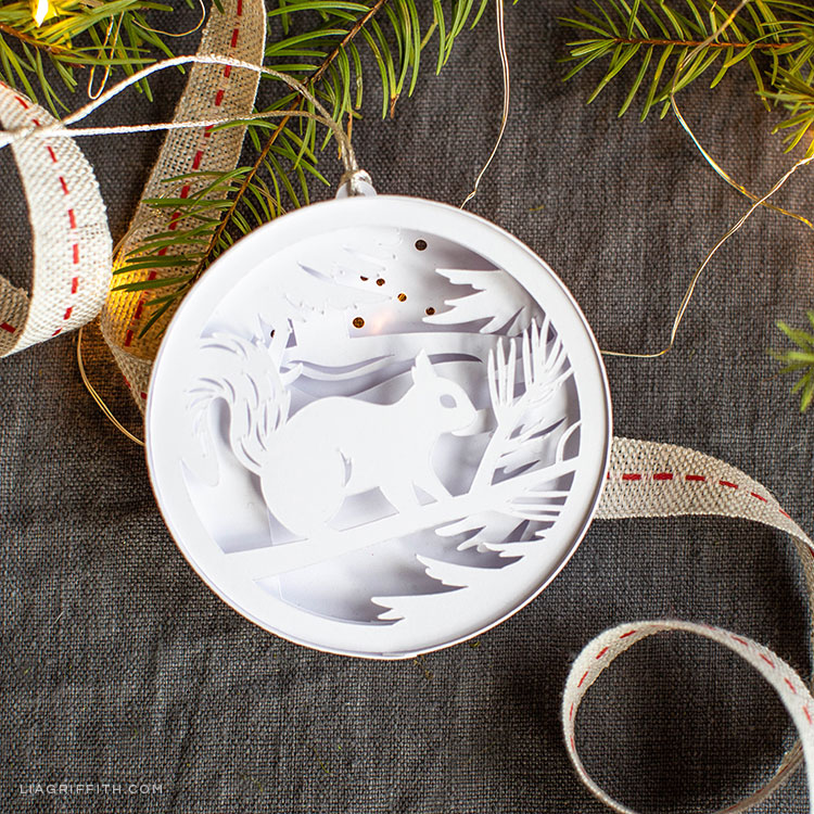 3D paper woodland ornament featuring a squirrel on a tree branch in the snow