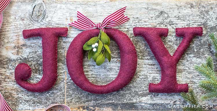 Felt JOY word with ribbon and crepe paper mistletoe