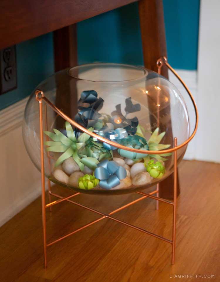 paper succulents arranged in a glass terrarium