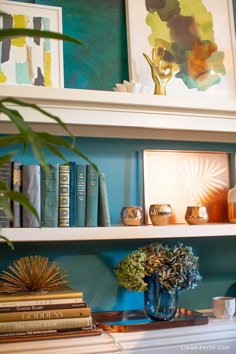 built-in shelves with books, home décor, and framed art