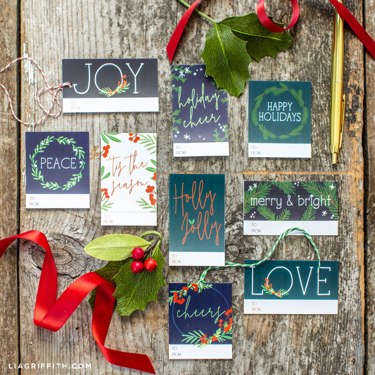 DIY holiday gift tags with winter greens and holly berries