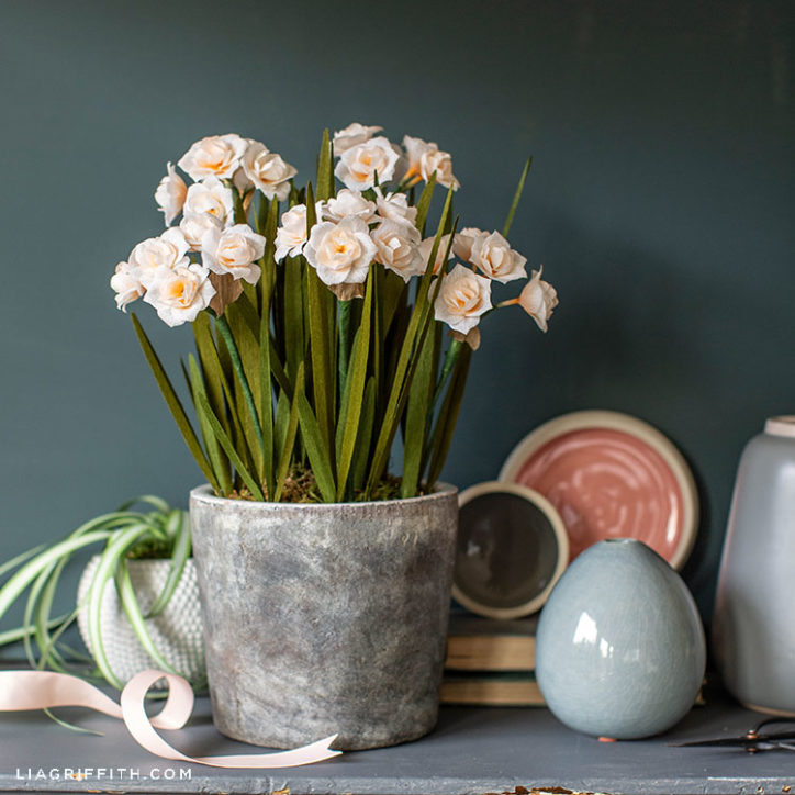 crepe paper double daffodils in pot on mantel