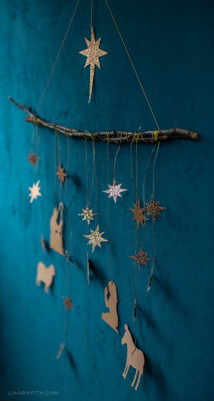 papercut nativity scene wall hanging on blue wall