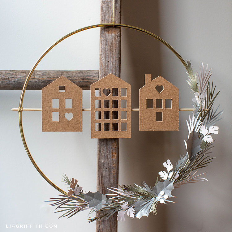 Scandi house and greenery wreath on wooden ladder