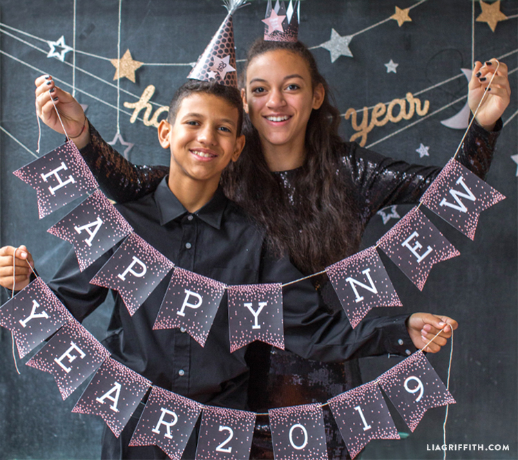 kids holding up happy new year 2019 printable banner