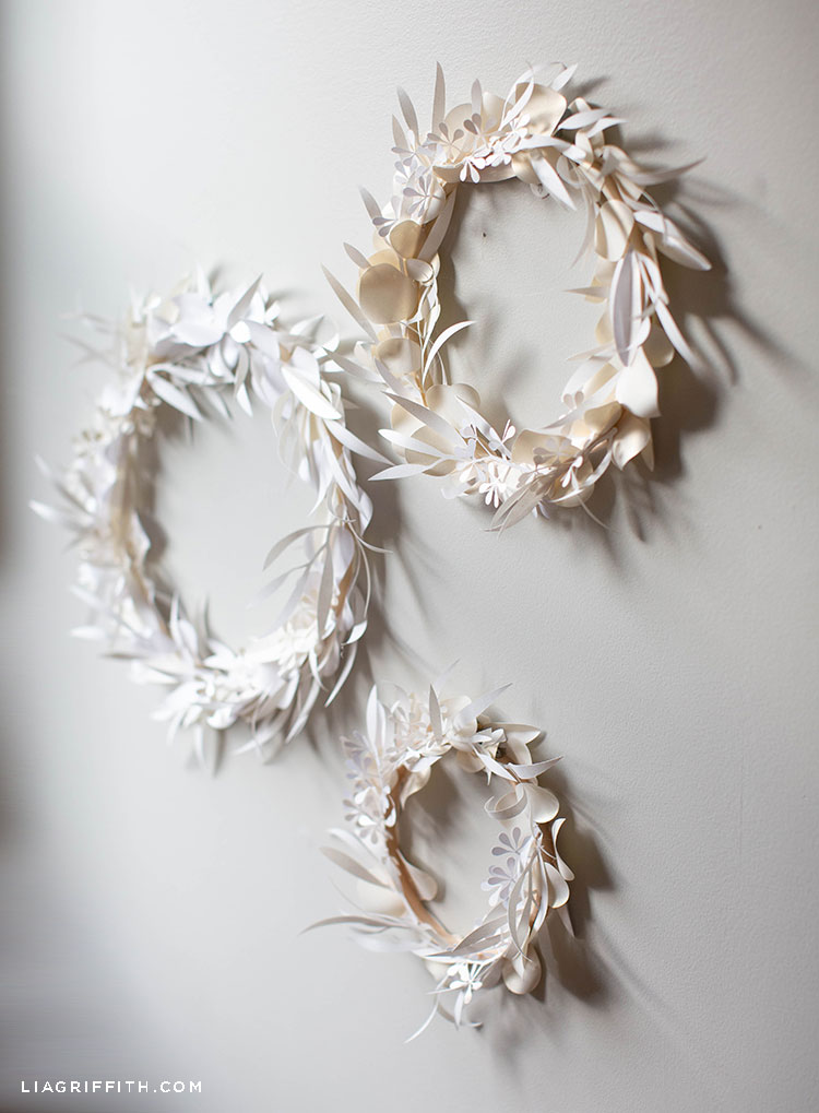 white paper eucalyptus wreaths hanging on wall