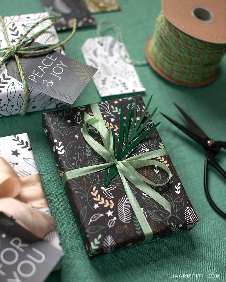 winter gift wrap on presents with green ribbon and holiday gift tags