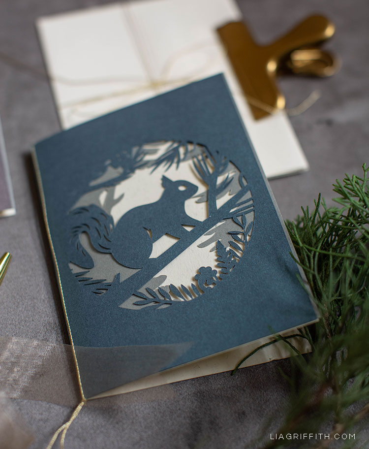 papercut woodland holiday card with squirrel on tree branch