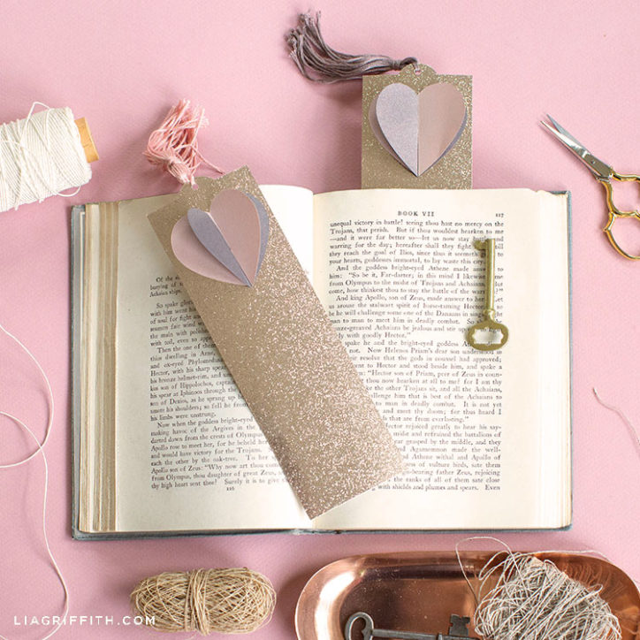 3D paper heart bookmarks on top of and inside a book