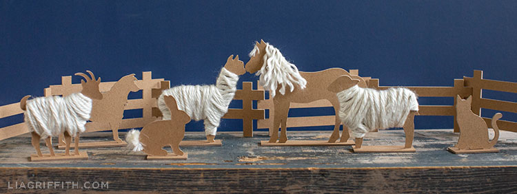 chipboard barnyard animals inside fence and outside fence