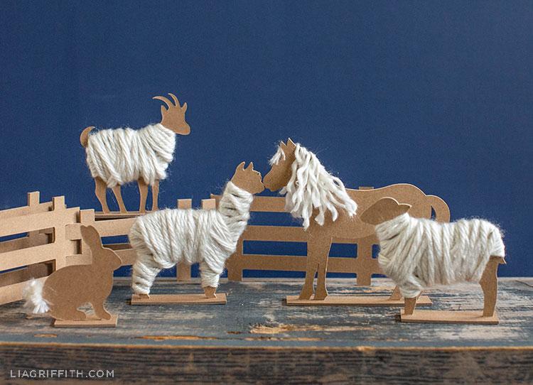 chipboard barnyard animals near fence
