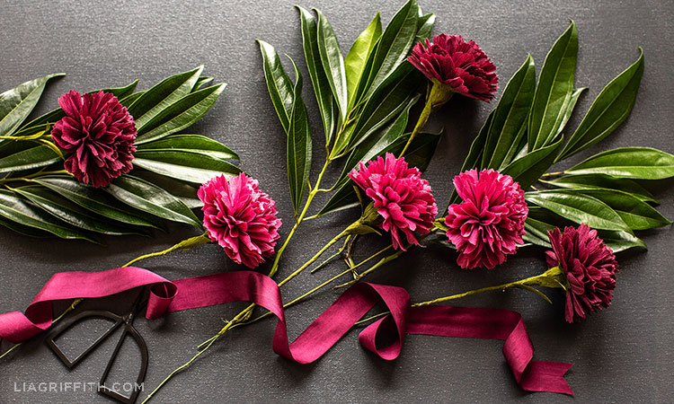 crepe paper carnations with leaves