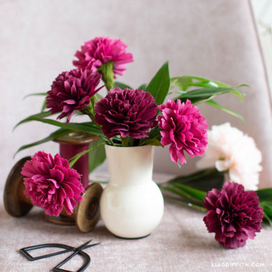 crepe paper carnations in white vase