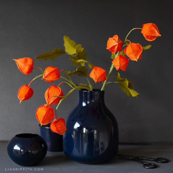 crepe paper Chinese lantern flowers in blue vase