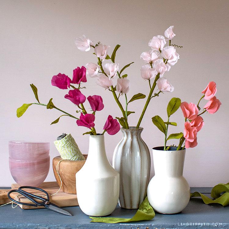 crepe paper sweet peas in vases on mantel