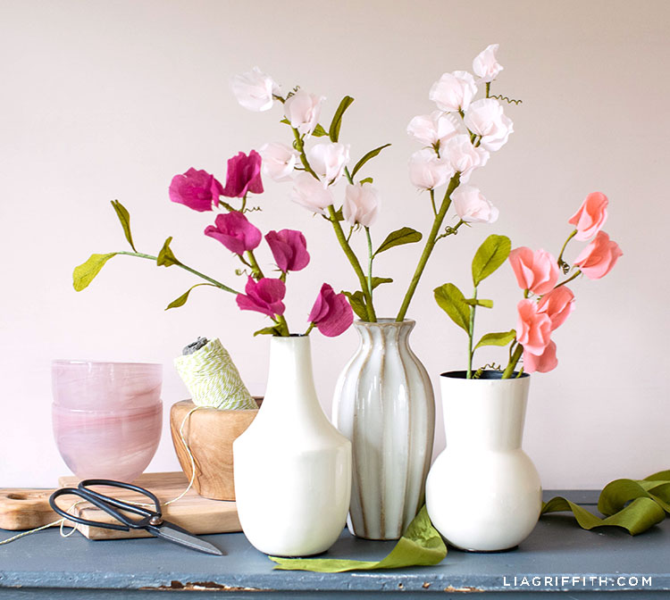 crepe paper sweet peas in vases on mantel