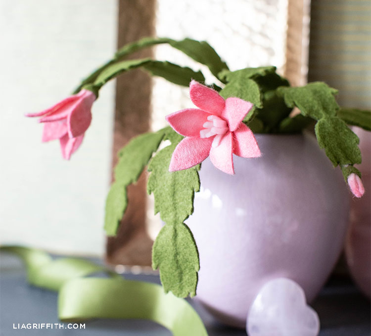 felt holiday cactus with pink flowers in pink pot and green ribbon