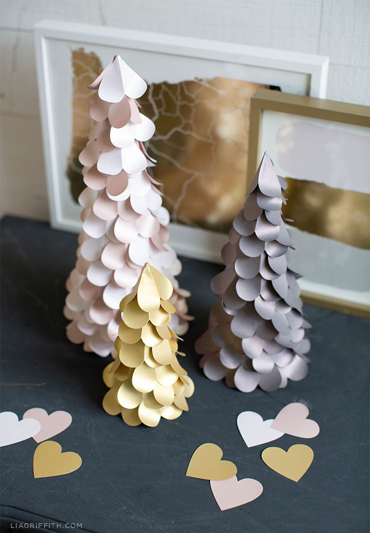 paper heart trees in pink, grey, and gold with cut-out paper hearts in front