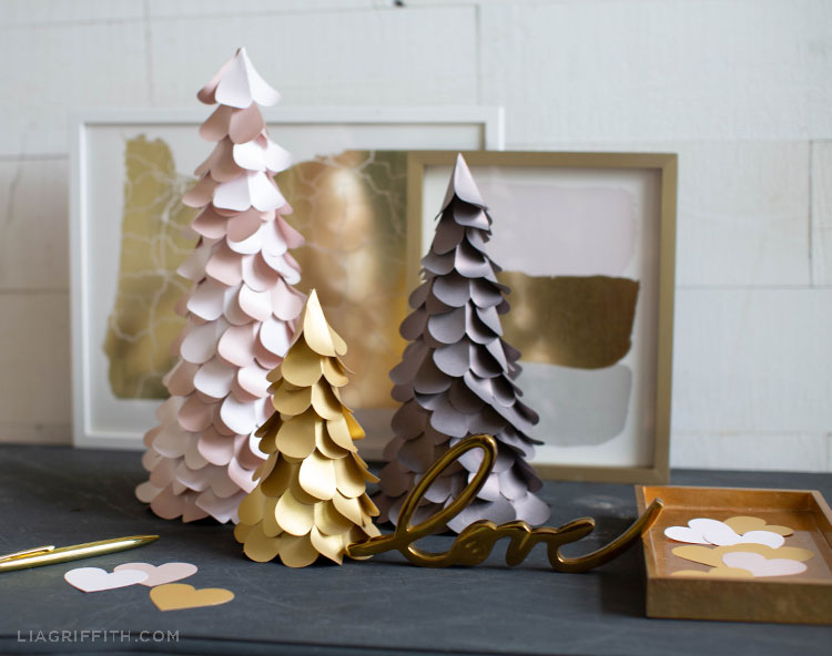 paper heart trees on grey mantel with gold wall art, gold tray, and gold love sign