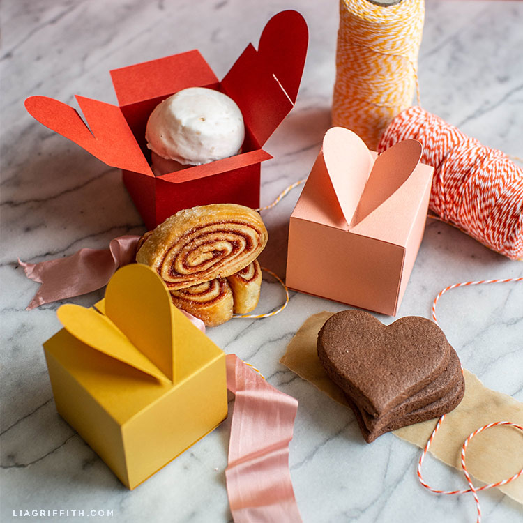paper heart treat box in coral and gold with cookies, ribbon, and twine