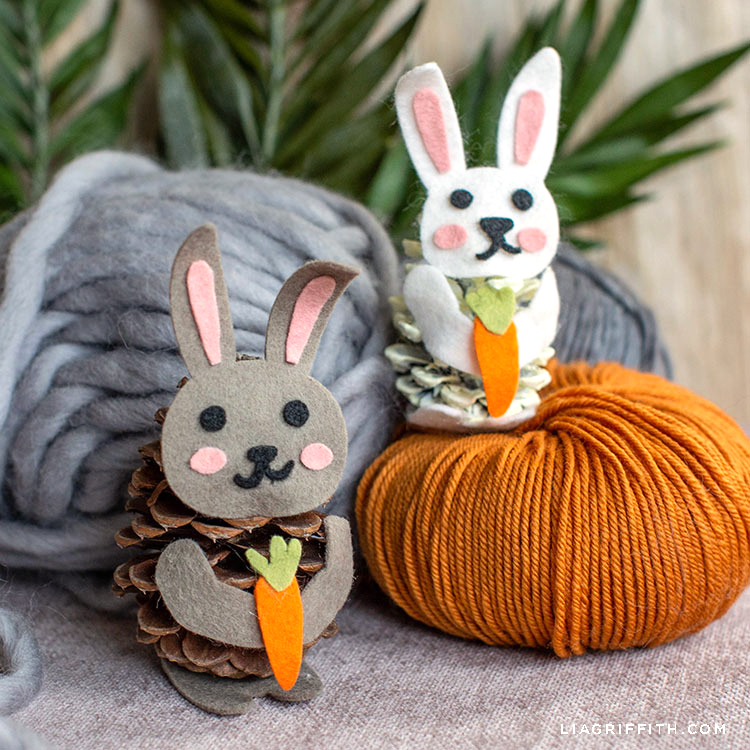 felt pinecone bunnies sitting by yarn