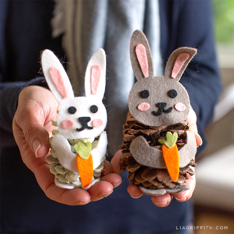 Hands holding felt pinecone bunnies