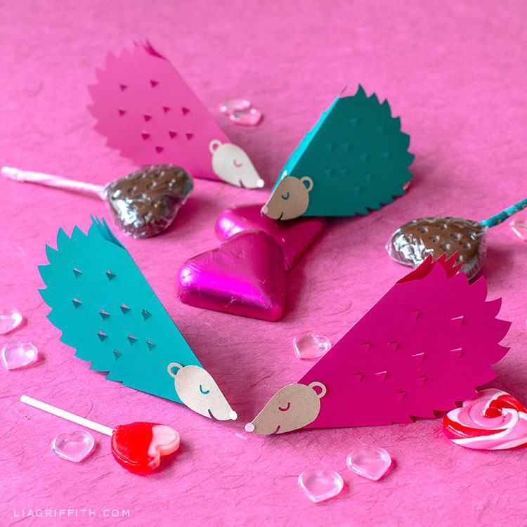 papercut hedgehog valentines with heart-shaped lollipops and chocolates