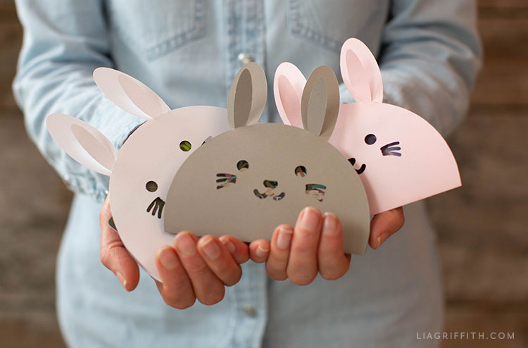 Woman holding Easter bunny gift card holders
