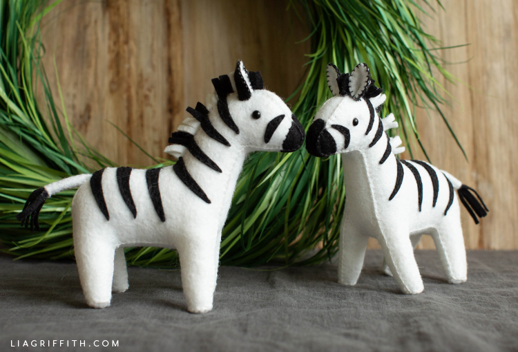felt zebra stuffies in front of paper wreath