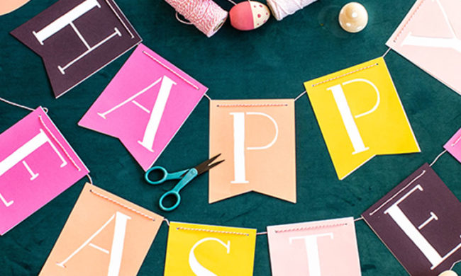 papercut Happy Easter banner on a teal background next to scissors and spools of thread