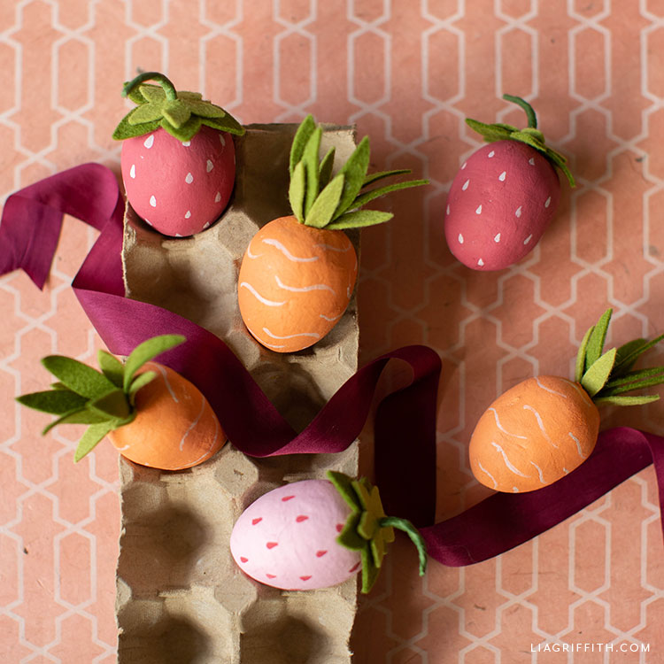 carrot and strawberry Easter eggs in carton