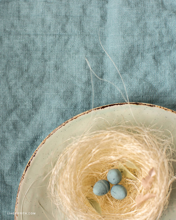 robin's nest made of natural sisal with spun cotton eggs