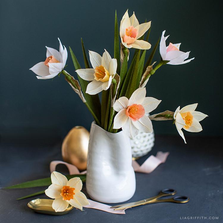 crepe paper daffodils in white vase
