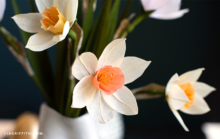 close-up of crepe paper daffodils in vase