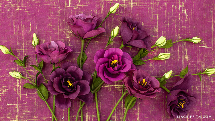 crepe paper lisianthus flowers against purple background