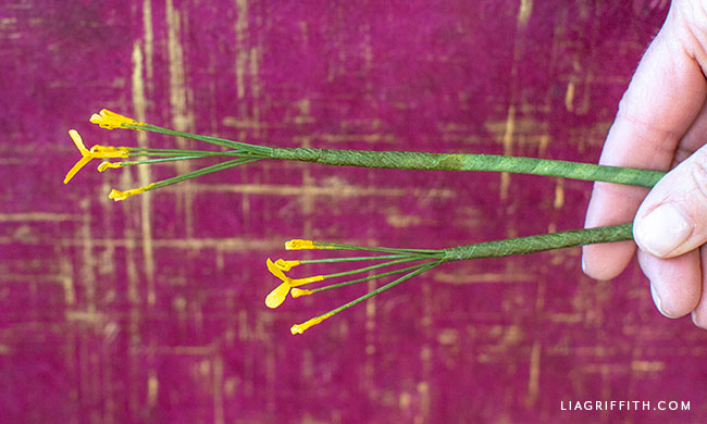 hand holding paper stems with crepe paper stamen
