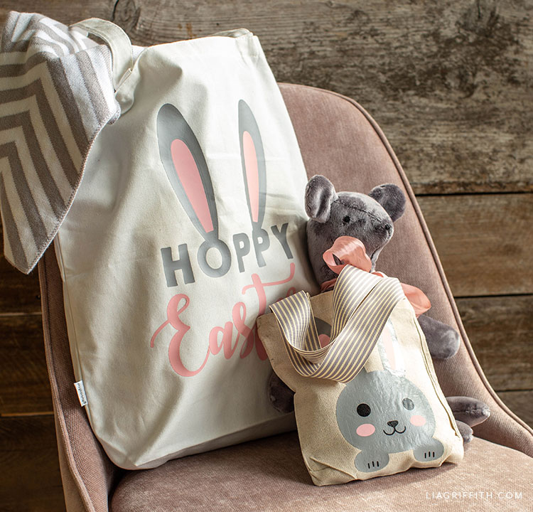 Easter tote bags on chair with stuffed bear and blanket
