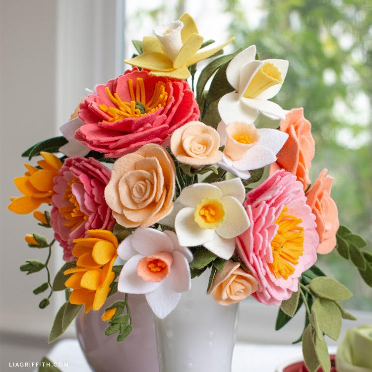 felt flower spring bouquet in vase in front of window