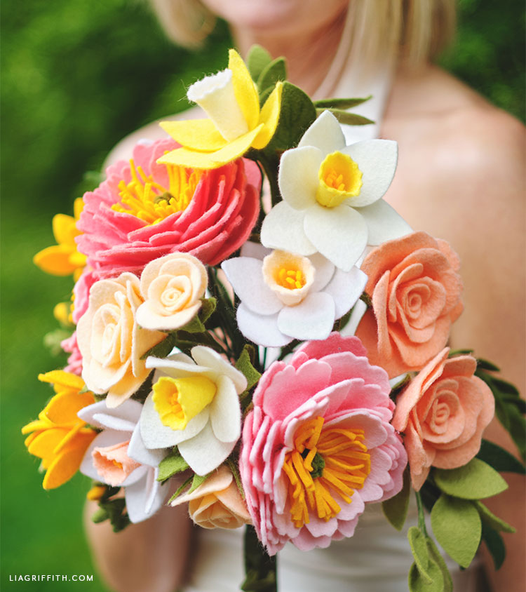 Woman in background with felt flower bridal bouquet for spring