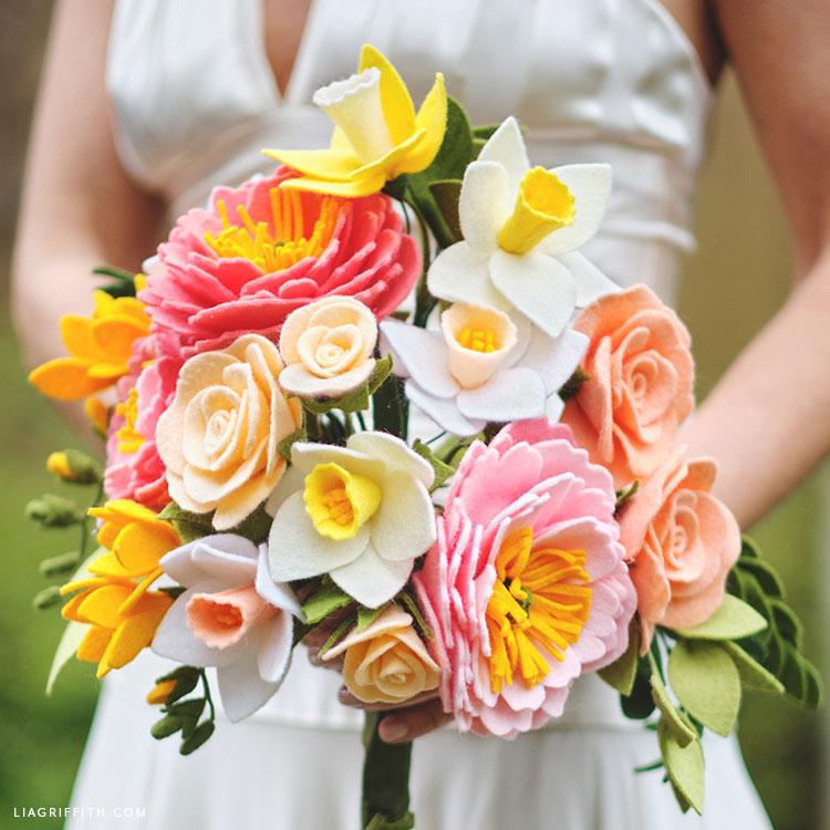 bride holding felt flower bridal bouquet for spring