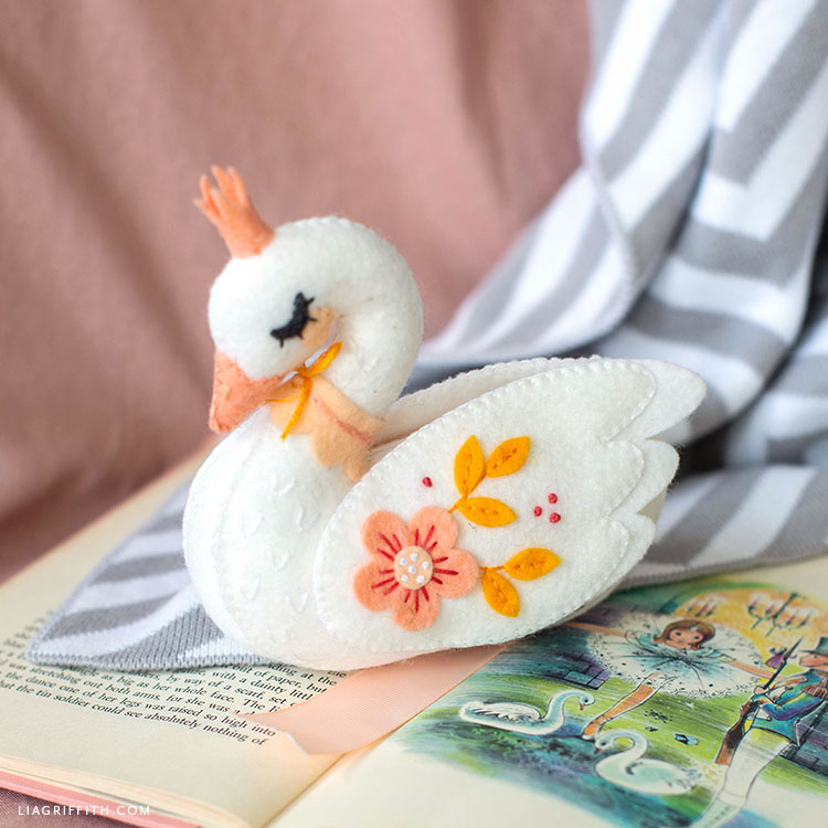 felt swan stuffie on kid's book