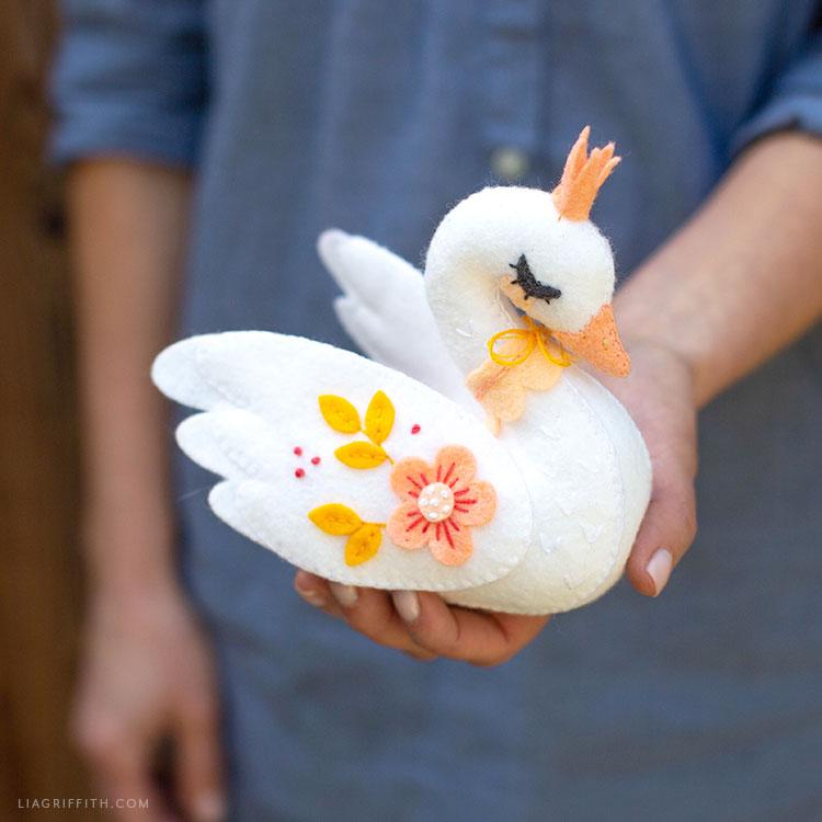 Woman holding felt swan stuffie