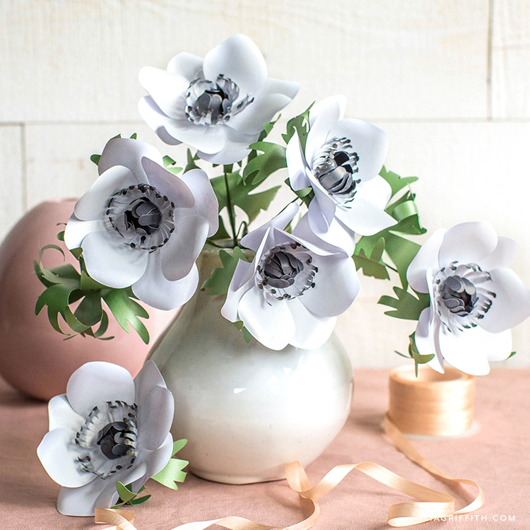 white and black frosted paper anemones in white vase