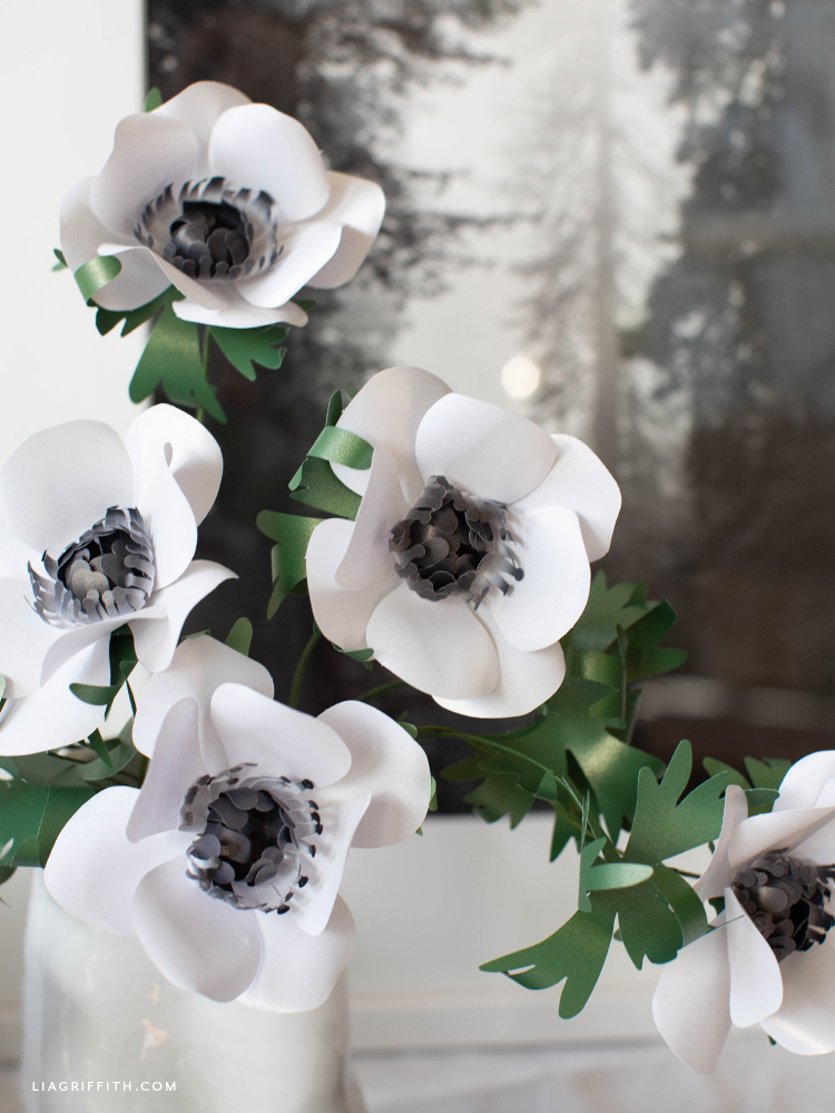 black and white frosted paper anemones in front of black and white wall art