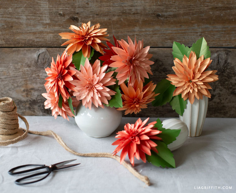 frosted paper dahlia flowers in vases