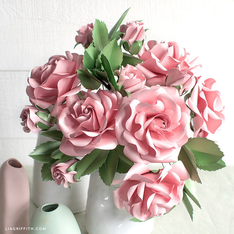pink frosted paper garden roses and buds in white vase