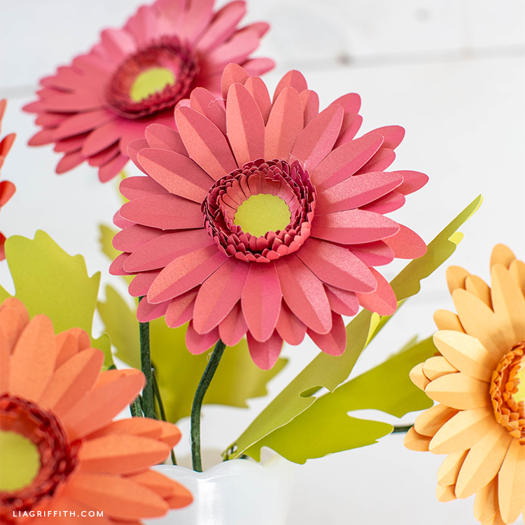 pink, orange, and yellow paper daisies