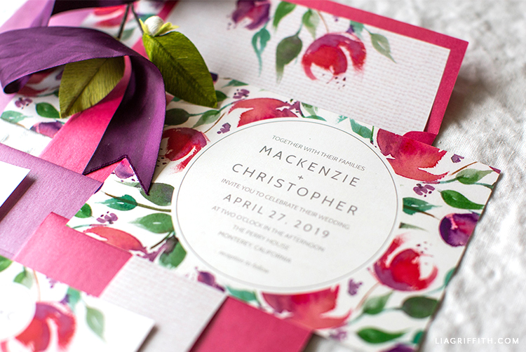 watercolor floral wedding invitations with purple ribbon