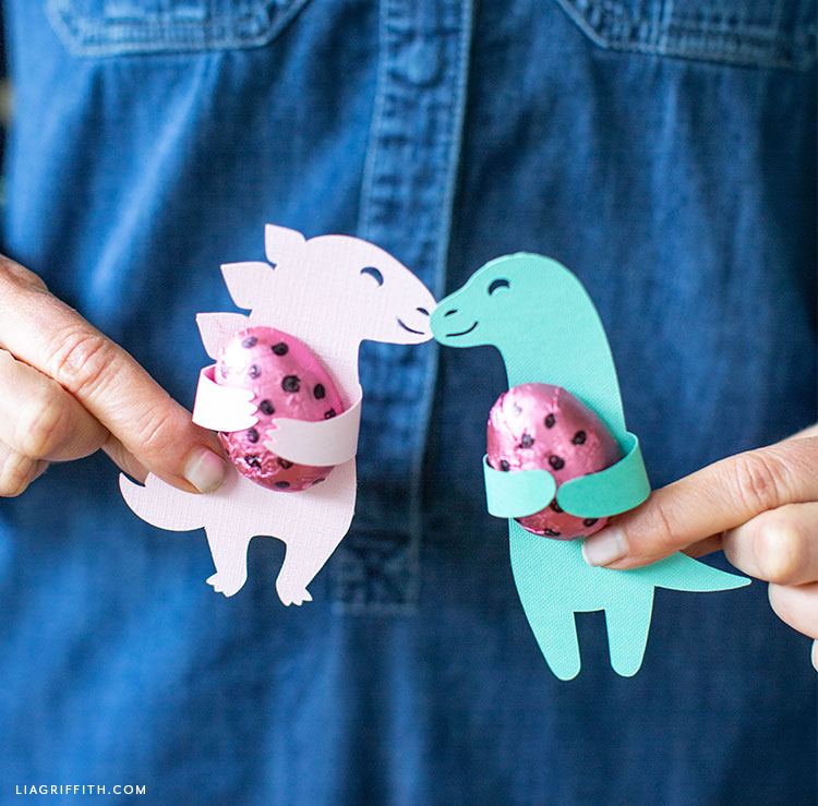 Person holding dinosaur candy huggers