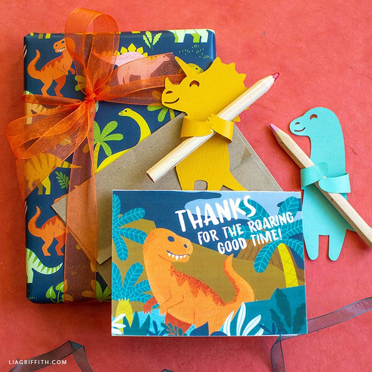 dinosaur thank-you cards with paper dinos holding pencils